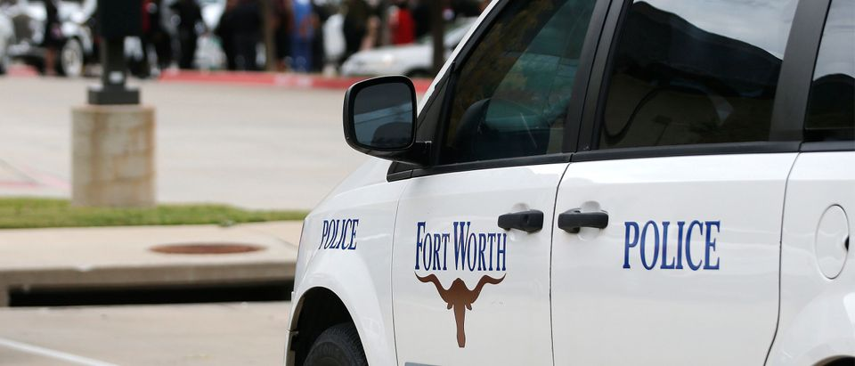 A Fort Worth Police car is parked outside the funeral service for Atatiana Jefferson. (Photo by Stewart F. House/Getty Images)
