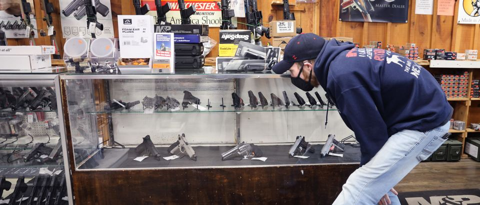 Alexander Carey shops for a new handgun at Freddie Bear Sports on April 08, 2021 in Tinley Park, Illinois. (Photo by Scott Olson/Getty Images)