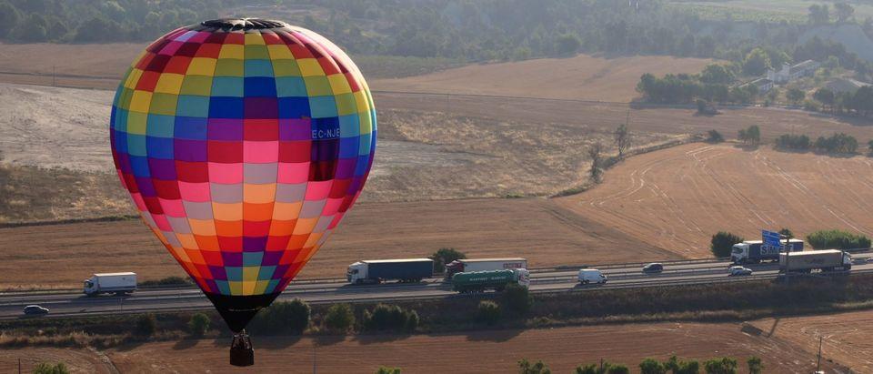 A hot-air balloon participates in the 25th European Hot Air Balloon Festival. (Photo by LLUIS GENE/AFP via Getty Images)