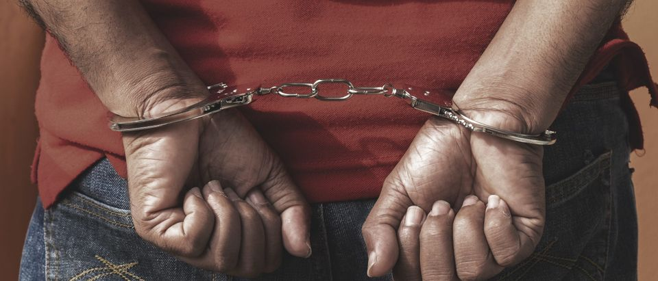 Man under arrest in handcuffs [Shutterstock]