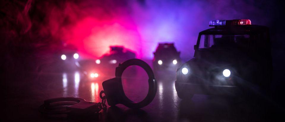 Police raid at night [Zef Art/Shutterstock]