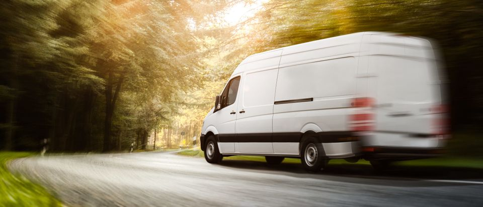 A truck drives along the road. This image does not depict the van used in the story [Shutterstock]