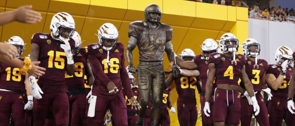 TEMPE, ARIZONA - SEPTEMBER 06: The Arizona State Sun Devils walk past a Pat Tillman statue before the NCAAF game against the Sacramento State Hornets at Sun Devil Stadium on September 06, 2019 in Tempe, Arizona. (Photo by Christian Petersen/Getty Images)