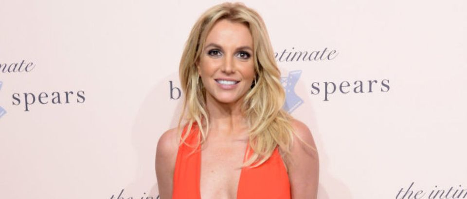 NEW YORK, NY - SEPTEMBER 09: Britney Spears poses at the exclusive unveiling of The Intimate Britney Spears at New York Public Library - Celeste Bartos Forum on September 9, 2014 in New York City. (Photo by Kevin Mazur/Getty Images for The Intimate Britney Spears)
