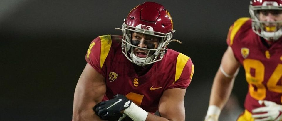 Dec 18, 2020; Los Angeles, California, USA; Southern California Trojans wide receiver Bru McCoy (4) carries the ball against the Oregon Ducks during the Pac-12 Championship at United Airlines Field at Los Angeles Memorial Coliseum. Oregon defeated USC 31-24. Mandatory Credit: Kirby Lee-USA TODAY Sports via Reuters