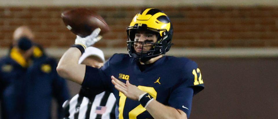 Nov 14, 2020; Ann Arbor, Michigan, USA; Michigan Wolverines quarterback Cade McNamara (12) passes in the second half against the Wisconsin Badgers at Michigan Stadium. Mandatory Credit: Rick Osentoski-USA TODAY Sports via Reuters