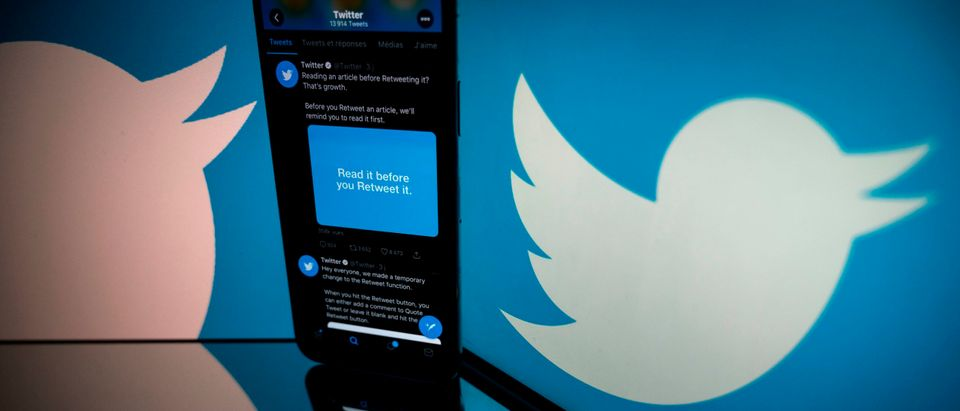 This photograph taken on October 26, 2020 shows the logo of US social network Twitter displayed on the screen of a smartphone and a tablet in Toulouse, southern France. (Photo by Lionel Bonaventure/AFP via Getty Images)