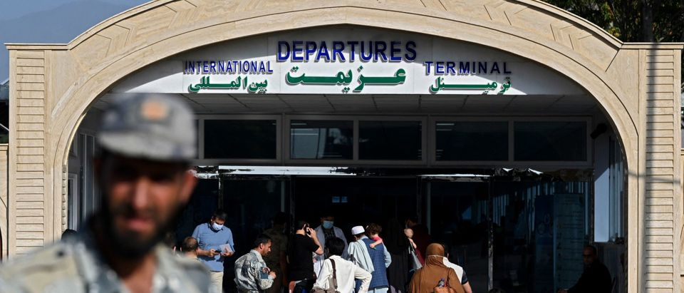 Passengers enter the departures terminal of the Hamid Karzai International Airport in Kabul on July 17, 2021. (Photo by SAJJAD HUSSAIN / AFP) (Photo by SAJJAD HUSSAIN/AFP via Getty Images)