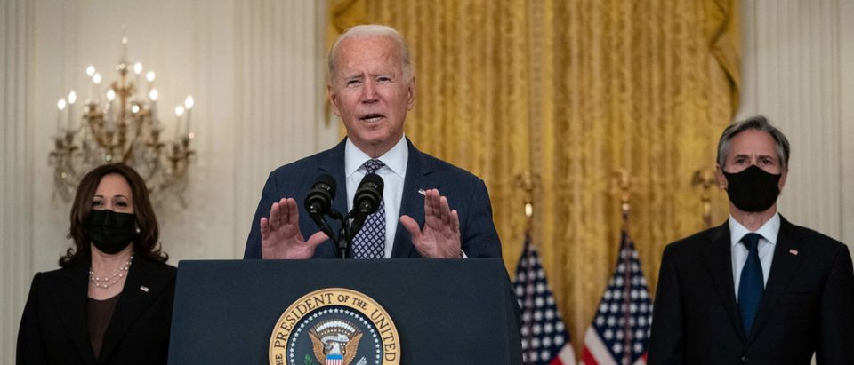 """US President Joe Biden, with Vice President Kamala Harris (L) and Secretary of State Antony Blinken, speaks about the ongoing US military evacuations of US citizens and vulnerable Afghans, in the East Room of the White House in Washington, DC, on August 20, 2021. - Biden said Friday he could not guarantee the final outcome of the emergency evacuation from Kabul's airport, calling it one of the most """"difficult"""" airlift operations ever. (Photo by ANDREW CABALLERO-REYNOLDS / AFP) (Photo by ANDREW CABALLERO-REYNOLDS/AFP via Getty Images)"""