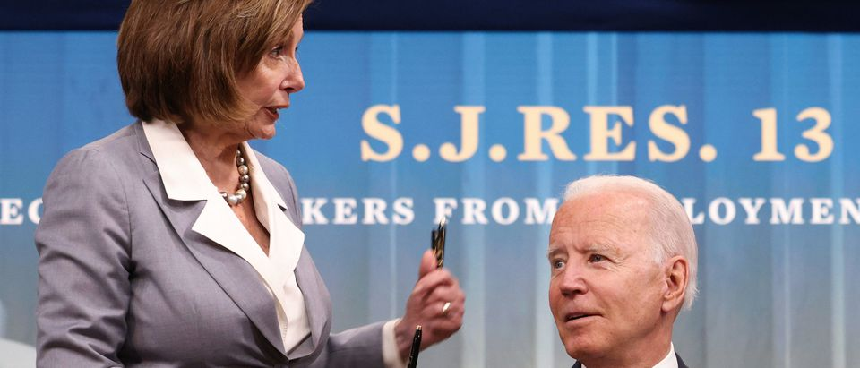 """WASHINGTON, DC - JUNE 30: U.S. Speaker of the House Nancy Pelosi receives a pen from President Joe Biden after he signed three Congressional Review Act bills into law June 30, 2021 in Washington, DC. The three bills were S.J.Res.13, relating to """"Update of Commission's Conciliation Procedures""""; S.J.Res.14, relating to """"Oil and Natural Gas Sector: Emission Standards for New, Reconstructed, and Modified Sources Review""""; and S.J.Res.15, relating to """"National Banks and Federal Savings Associations as Lenders."""" (Photo by Win McNamee/Getty Images)"""