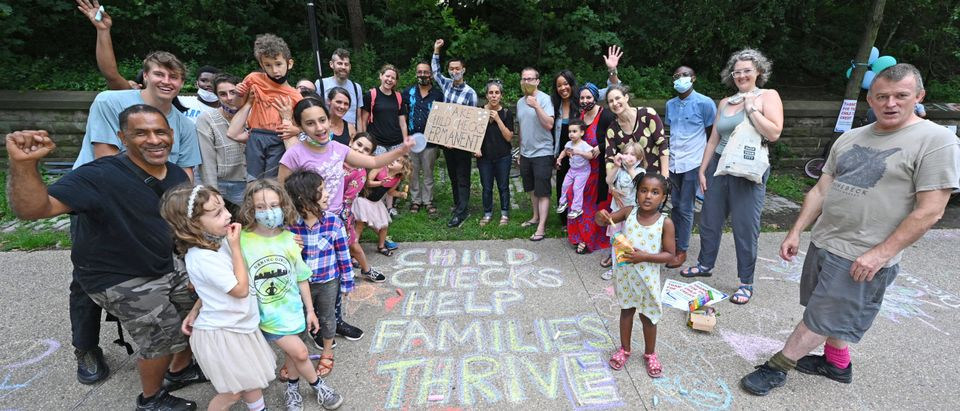 Parents Celebrate New Monthly Child Tax Credit Payments Outside Senator Schumer's Home, Urge Congress To Make Them Permanent