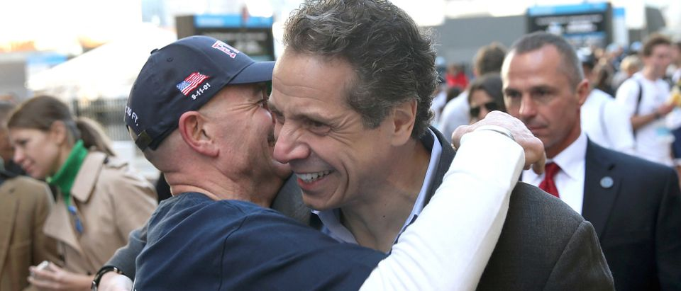 New York Gov. Andrew Cuomo (R) hugs a fireman at end of the first annual 9/11 Memorial 5K Run/Walk on April 21, 2013 in New York City. Security was tight for the race, as has been the case in large scale events around the country since the Boston Marathon bombings. April 21 marks the anniversary that President Barack Obama signed into law legislation making 9/11 a day of service and volunteerism in memory of the victims of the 2001 attacks. (Photo by John Moore/Getty Images)