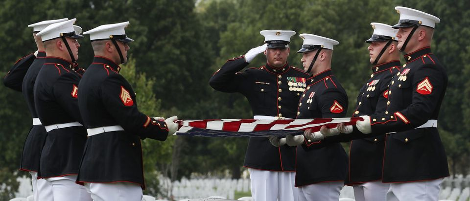 US Marines fold an American flag over the remains of US Marine PFC Anthony Brozyna, of Hartford, CT., during a full honor burial service at Arlington National Cemetary, August 31, 2016 in Washington, DC. Brozyna was 22 years old when he was killed in World War II on the island of Betio in the Tarawa Atoll of the Gilbert Islands during a battle on November 20, 1943. (Photo by Mark Wilson/Getty Images)