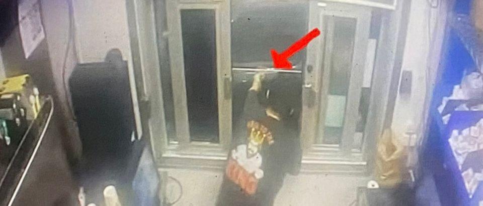 Burger King Employee points gun at customers