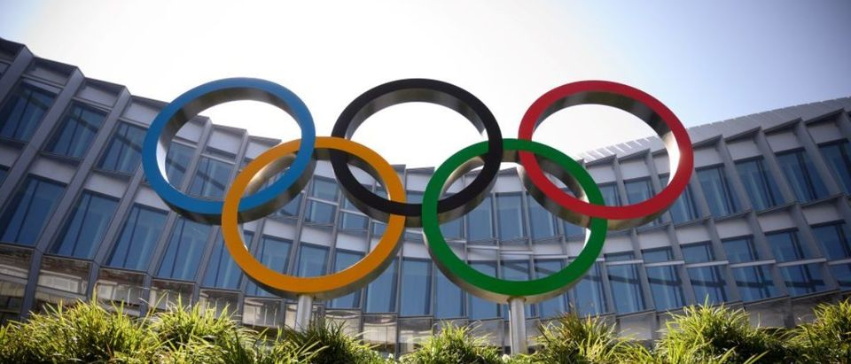"""The Olympic Rings logo is pictured in front of the headquarters of the International Olympic Committee (IOC) in Lausanne on March 18, 2020, as doubts increase over whether Tokyo can safely host the summer Games amid the spread of the COVID-19. - Olympic chiefs acknowledged on March 18, 2020 there was no """"ideal"""" solution to staging the Tokyo Olympics amid a backlash from athletes as the deadly coronavirus pandemic swept the globe. The Tokyo Olympics are scheduled to run between July 24 and August 9, 2020. (Photo by FABRICE COFFRINI/AFP via Getty Images)"""