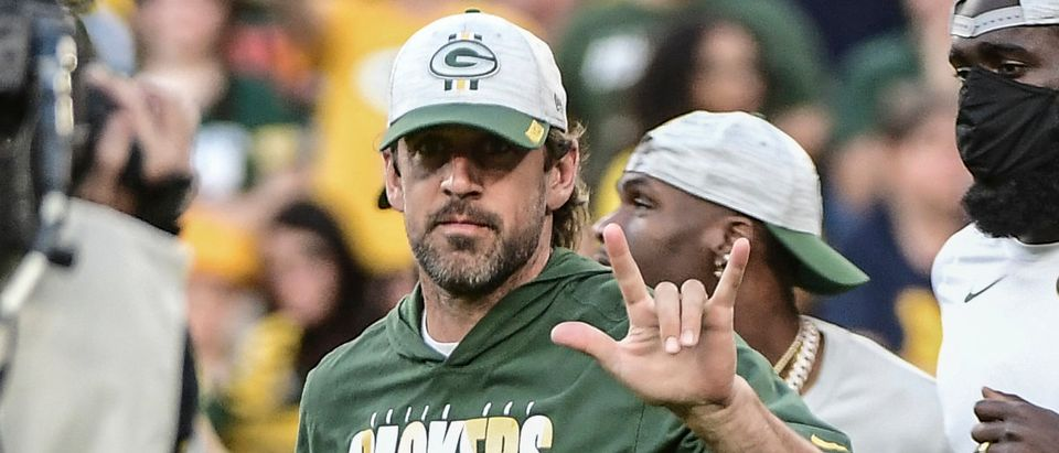 Aug 14, 2021; Green Bay, Wisconsin, USA; Green Bay Packers quarterback Aaron Rodgers (12) reacts as players are introduced before a game against the Houston Texans at Lambeau Field. Mandatory Credit: Benny Sieu-USA TODAY Sports via Reuters