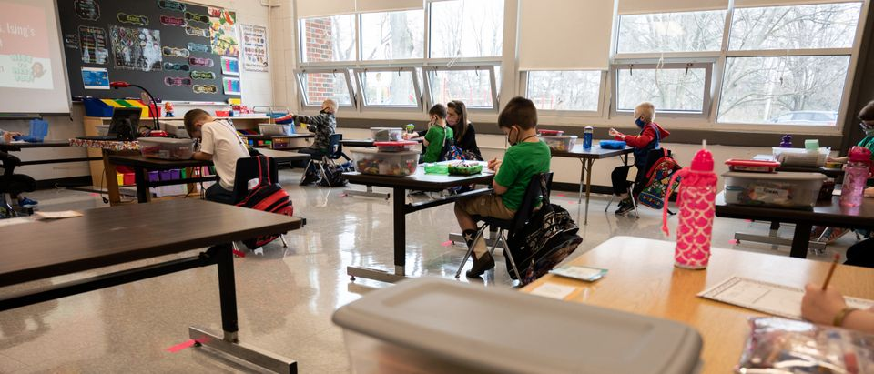 Students and teachers participate in a socially distanced classroom session at Medora Elementary School on March 17, 2021 in Louisville, Kentucky. (Photo by Jon Cherry/Getty Images)