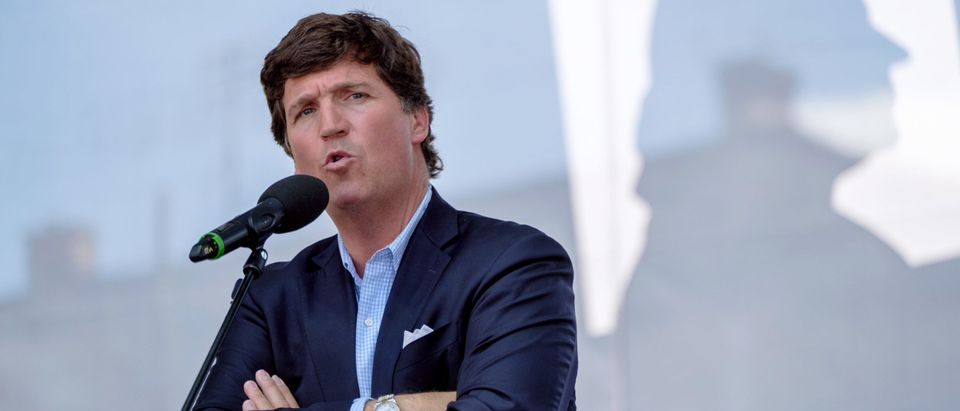 """ESZTERGOM, HUNGARY - AUGUST 07: Tucker Carlson speaks during the Mathias Corvinus Collegium (MCC) Feszt on August 7, 2021 in Esztergom, Hungary. The multiday political event was organized by the Mathias Corvinus Collegium (MCC), a privately managed foundation that recently received more than $1.7 billion in government money and assets. The leader of its main board, Balazs Orban, who is also a state secretary in the prime minister's office, said MCC's priority is promoting """"patriotism"""" among the next generation of Hungary's leaders. (Photo by Janos Kummer/Getty Images)"""