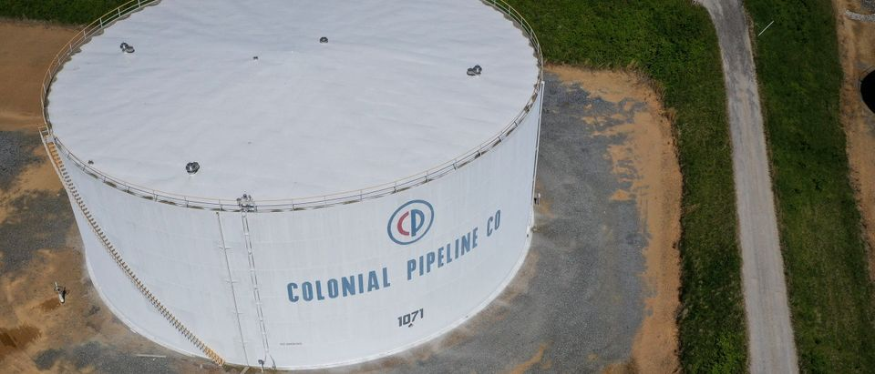 In an aerial view, fuel holding tanks are seen at Colonial Pipeline's Dorsey Junction Station on May 13, 2021 in Woodbine, Maryland. (Photo by Drew Angerer/Getty Images)
