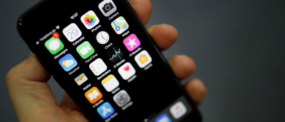The logo of FaceTime is pictured on an Iphone screen. (Photo by ODD ANDERSEN/AFP via Getty Images)