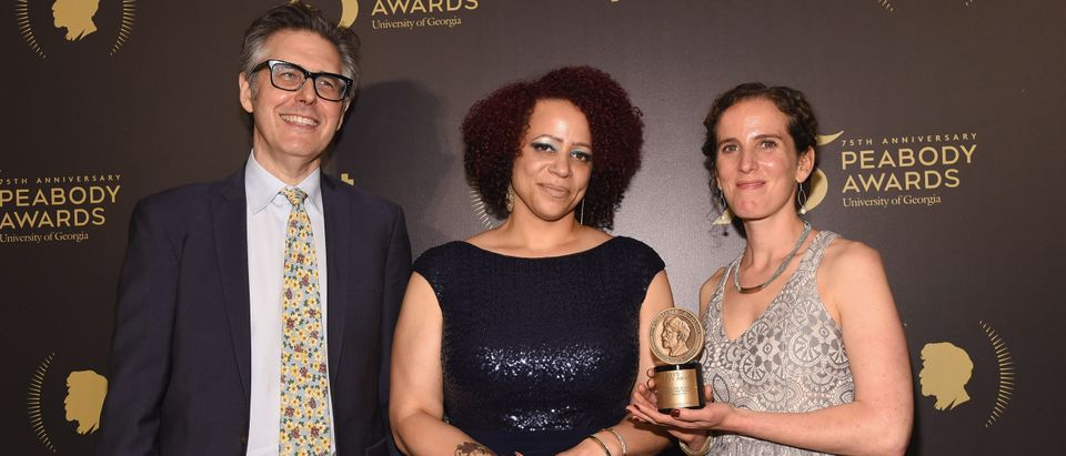 Ira Glass, Nikole Hannah-Jones, and Chana Joffe-Walt pose with award during The 75th Annual Peabody Awards Ceremony. (Photo by Gary Gershoff/Getty Images for Peabody)