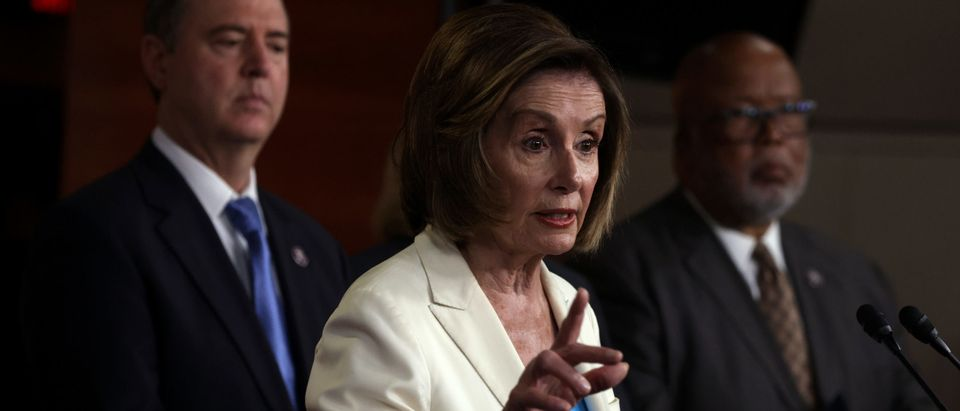 U.S. Speaker of the House Rep. Nancy Pelosi (D-CA) (2nd L) speaks as Rep. Bennie Thompson (D-MS) (R) and Rep. Adam Schiff (D-CA) (L) listen during a weekly news conference at the U.S. Capitol July 1, 2021 in Washington, DC. (Photo by Alex Wong/Getty Images)