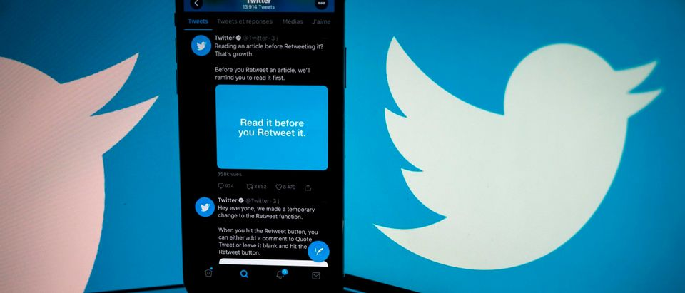 The logo of US social network Twitter displayed on the screen of a smartphone. (Photo by LIONEL BONAVENTURE/AFP via Getty Images)