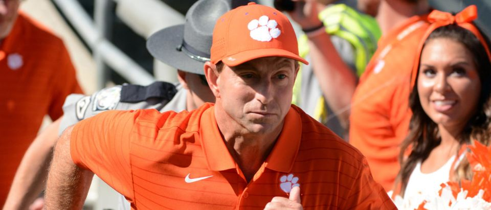 Sep 25, 2021; Raleigh, North Carolina, USA; Clemson Tigers head coach Dabo Swinney takes the field prior to a game against the North Carolina State Wolfpack at Carter-Finley Stadium. Mandatory Credit: Rob Kinnan-USA TODAY Sports via Reuters