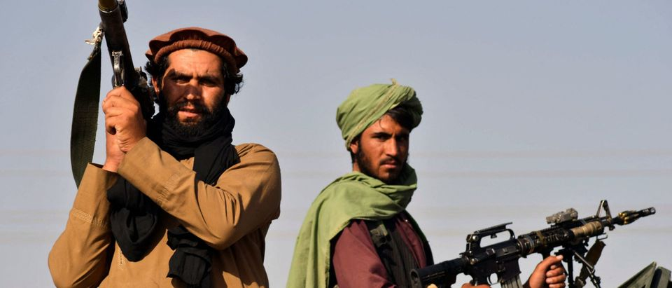 Taliban fighters stand on an armoured vehicle before parading along a road to celebrate after the US pulled all its troops out of Afghanistan, in Kandahar on September 1, 2021 following the Talibans military takeover of the country. (Photo by JAVED TANVEER / AFP) (Photo by JAVED TANVEER/AFP via Getty Images)