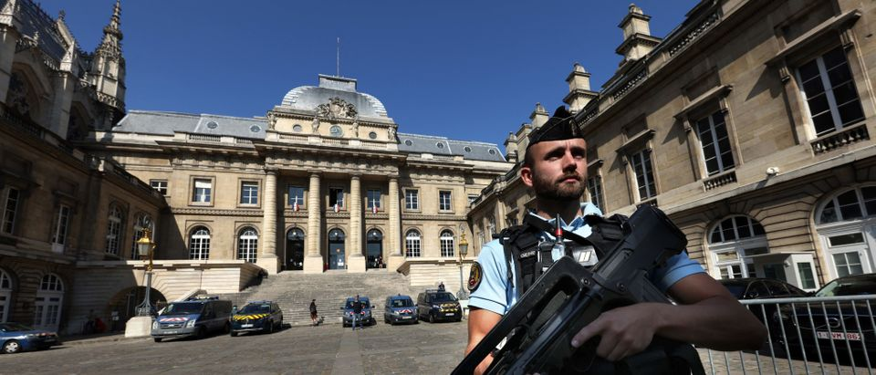 An armed gendarme stands guard on September 2, 2021 at the main entrance of the Palais de Justice of Paris - Paris' courthouse, ahead of the November 13, 2015 Paris attacks' trial scheduled to be held on September 8, 2021. (Photo by THOMAS COEX/AFP via Getty Images)