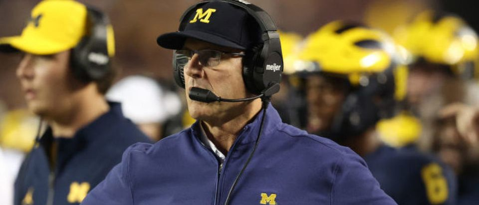 ANN ARBOR, MICHIGAN - SEPTEMBER 11: Head coach Jim Harbaugh looks on in the first half while playing the Washington Huskies at Michigan Stadium on September 11, 2021 in Ann Arbor, Michigan. (Photo by Gregory Shamus/Getty Images)