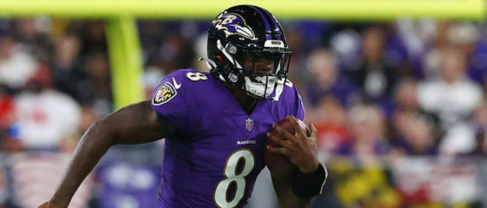 BALTIMORE, MARYLAND - SEPTEMBER 19: Lamar Jackson #8 of the Baltimore Ravens scrambles with the ball against the Kansas City Chiefs during the second quarter at M&T Bank Stadium on September 19, 2021 in Baltimore, Maryland. (Photo by Todd Olszewski/Getty Images)