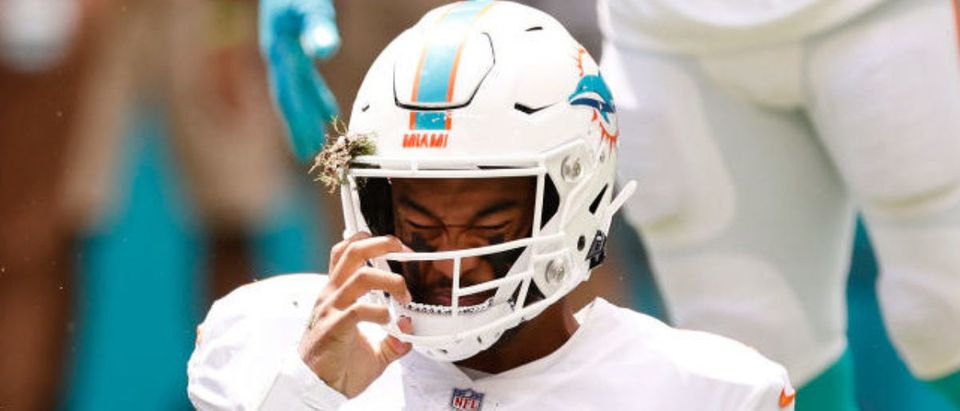 MIAMI GARDENS, FLORIDA - SEPTEMBER 19: Tua Tagovailoa #1 of the Miami Dolphins reacts after being sacked against the Buffalo Bills during the first quarter at Hard Rock Stadium on September 19, 2021 in Miami Gardens, Florida. (Photo by Michael Reaves/Getty Images)