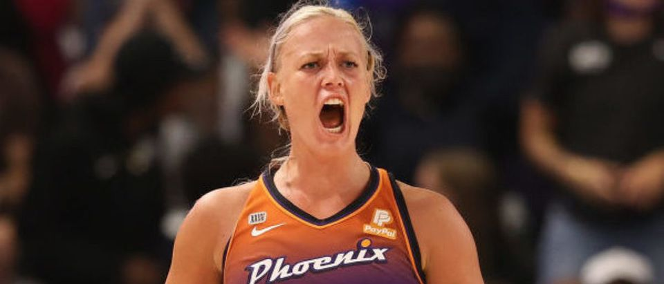 PHOENIX, ARIZONA - SEPTEMBER 23: Sophie Cunningham #9 of the Phoenix Mercury reacts after a three-point shot against the New York Liberty during the second half of the first round WNBA playoffs at Grand Canyon University Arena on September 23, 2021 in Phoenix, Arizona. The Mercury defeated the Liberty 83-82. (Photo by Christian Petersen/Getty Images)
