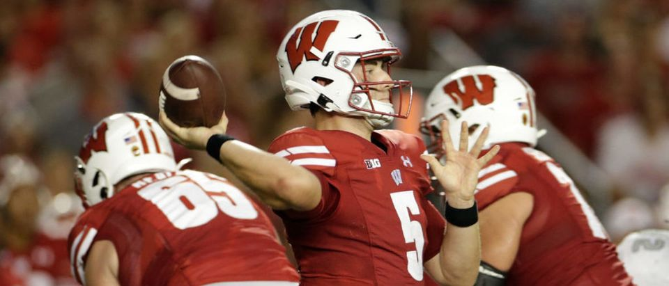 MADISON, WISCONSIN - SEPTEMBER 11: Graham Mertz #5 of the Wisconsin Badgers throws a pass in the first half against the Eastern Michigan Eagles at Camp Randall Stadium on September 11, 2021 in Madison, Wisconsin. (Photo by John Fisher/Getty Images)