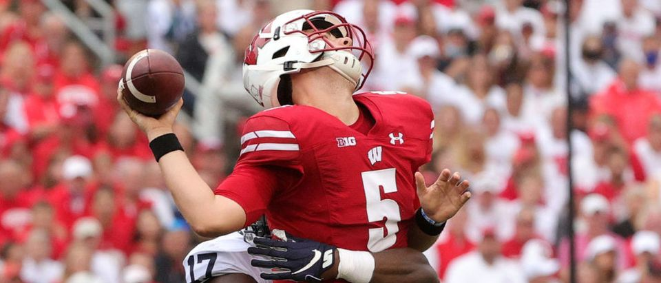 MADISON, WISCONSIN - SEPTEMBER 04: Graham Mertz #5 of the Wisconsin Badgers is hit by Arnold Ebiketie #17 of the Penn State Nittany Lions during the first quarter at Camp Randall Stadium on September 04, 2021 in Madison, Wisconsin. (Photo by Stacy Revere/Getty Images)