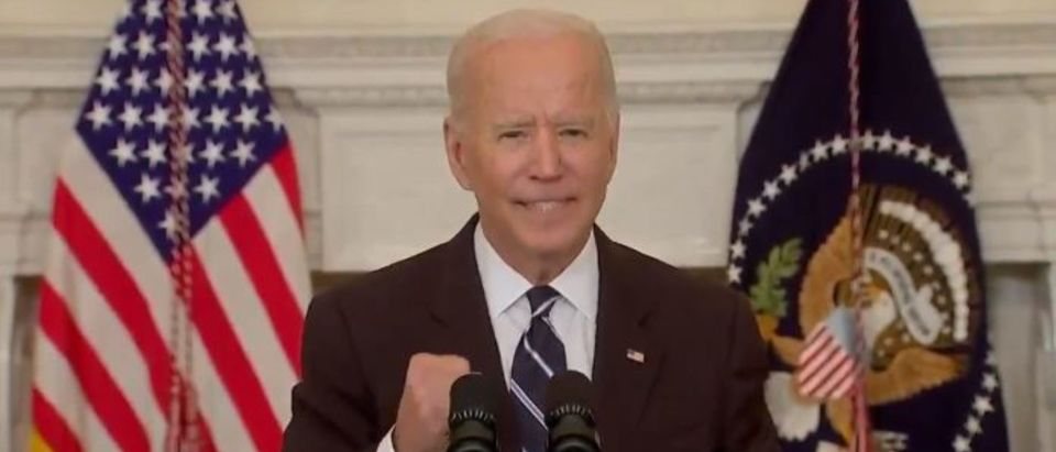 Biden whispers 'get vaccinated' before pumping his fist and exiting the stage.(Screenshot/Twitter/Daily Caller)