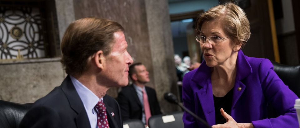 Sen. Richard Blumenthal talks with Sen. Elizabeth Warren (D-MA) before the start of a Senate Armed Services Committee hearing concerning the roles and responsibilities for defending the nation against cyber attacks, on Capitol Hill, October 19, 2017 in Washington, DC. (Photo by Drew Angerer/Getty Images)