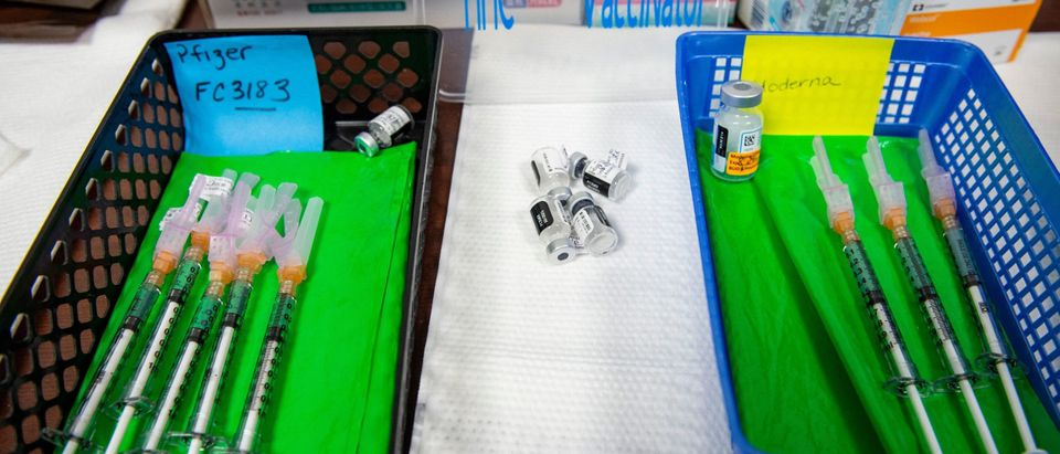 Needles preloaded with the Moderna and Pfizer-BioNTech Covid-19 vaccines sit in baskets awaiting patients at the vaccine clinic at Hartford Hospital in Hartford, Connecticut on August 24, 2021.(Photo by JOSEPH PREZIOSO/AFP via Getty Images)