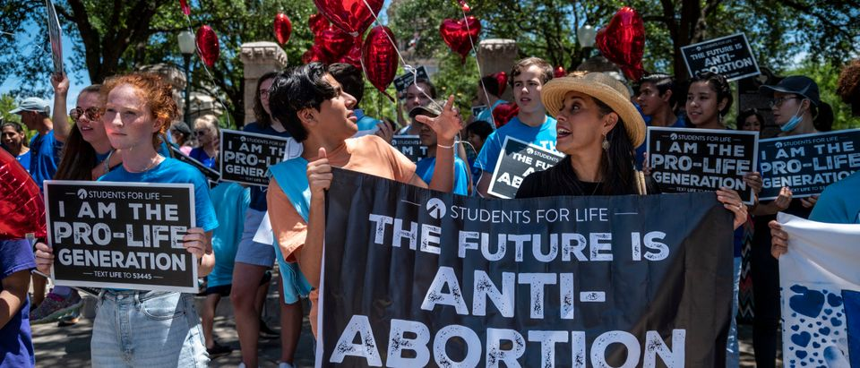 Pro-life protesters stand near the gate of the Texas state capitol at a protest outside the Texas state capitol on May 29, 2021 in Austin, Texas. (Photo by Sergio Flores/Getty Images)