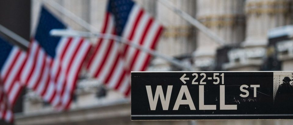 A Wall St sign hangs at the New York Stock Exchange (NYSE) at Wall Street on March 23, 2021 in New York City. (Photo by ANGELA WEISS/AFP via Getty Images)