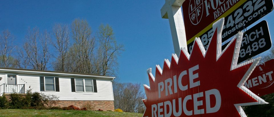 For Sale Signs Multiply With Weakening Housing Market