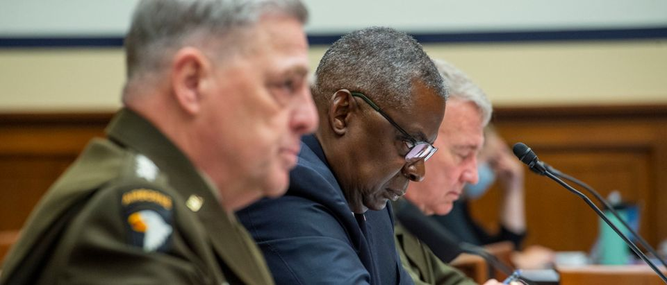 Chairman of the Joint Chiefs of Staff Gen. Mark A. Milley, Secretary of Defense Lloyd Austin and Gen. Kenneth McKenzie, commander of the U.S. Central Command, testify during a House Armed Services Committee hearing on Ending the U.S. Military Mission in Afghanistan in the Rayburn House Office Building at the U.S. Capitol on September 29, 2021 in Washington, DC. (Photo by Rod Lamkey-Pool/Getty Images)
