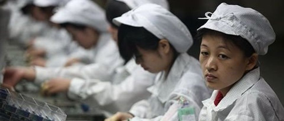 Undercover image of working conditions at iPhone manufacturer Foxconn